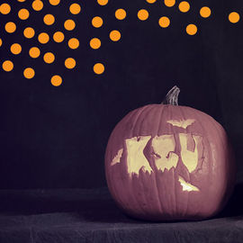 "A pumpkin with the letters ""KSU"" carved into it."