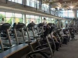 Treadmills line the bottom floor of the Student Recreation and Wellness Center