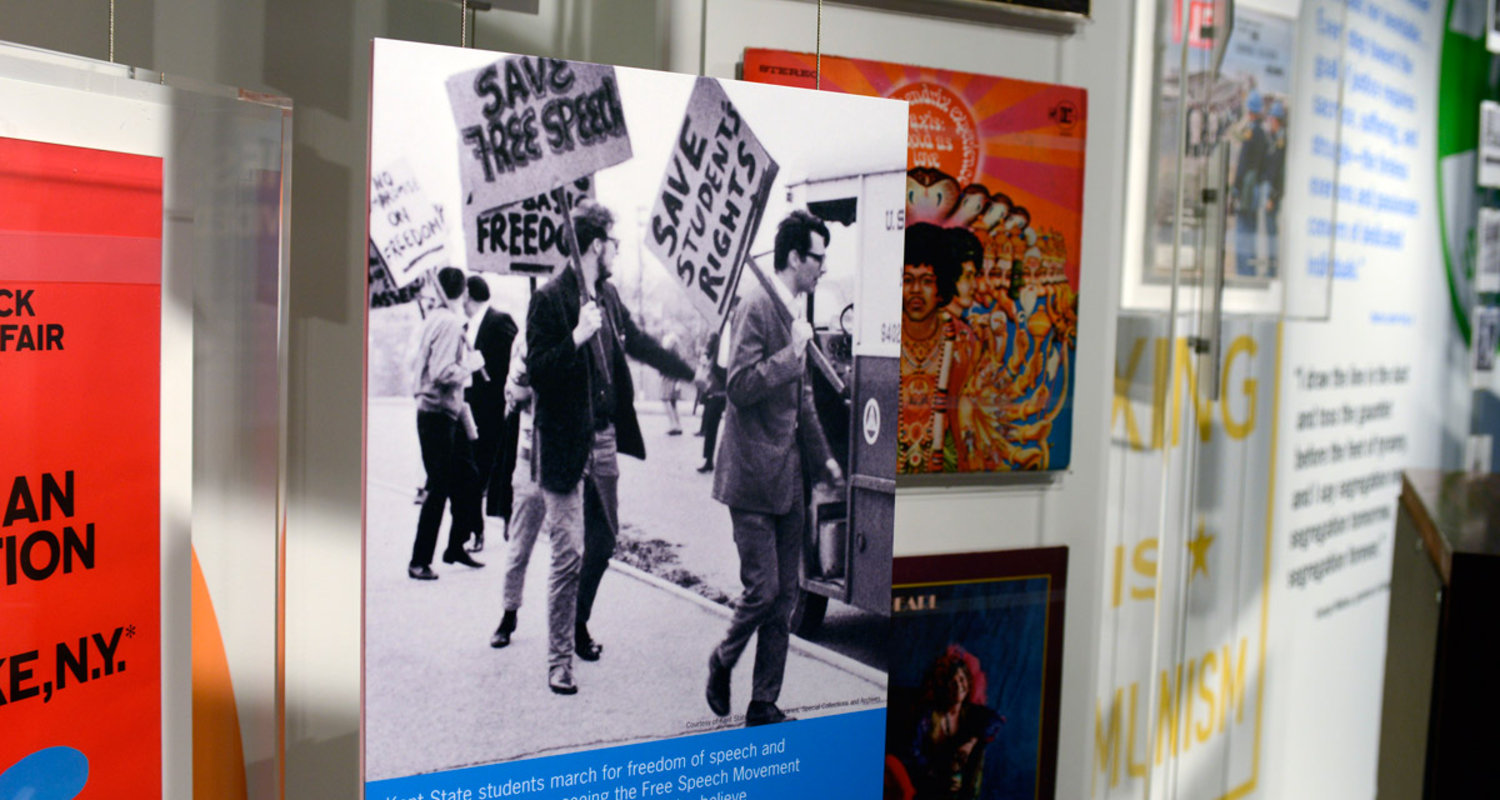 Photo in gallery one of the May 4 Visitors Center, showing the free speech movement demonstrators at Kent State University