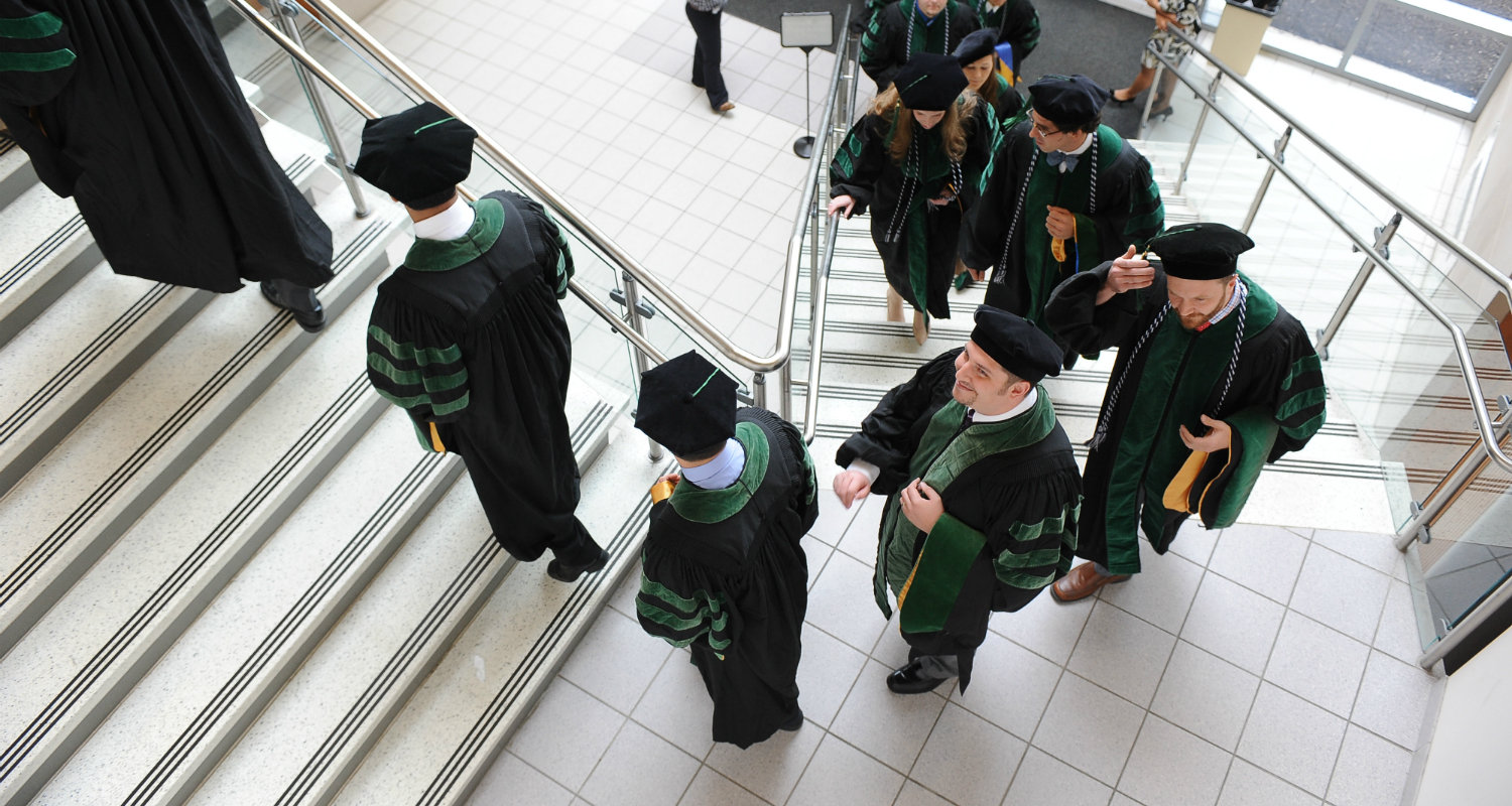 Graduates of the College of Podiatric Medicine line up for commencement at Cartwright Hall.
