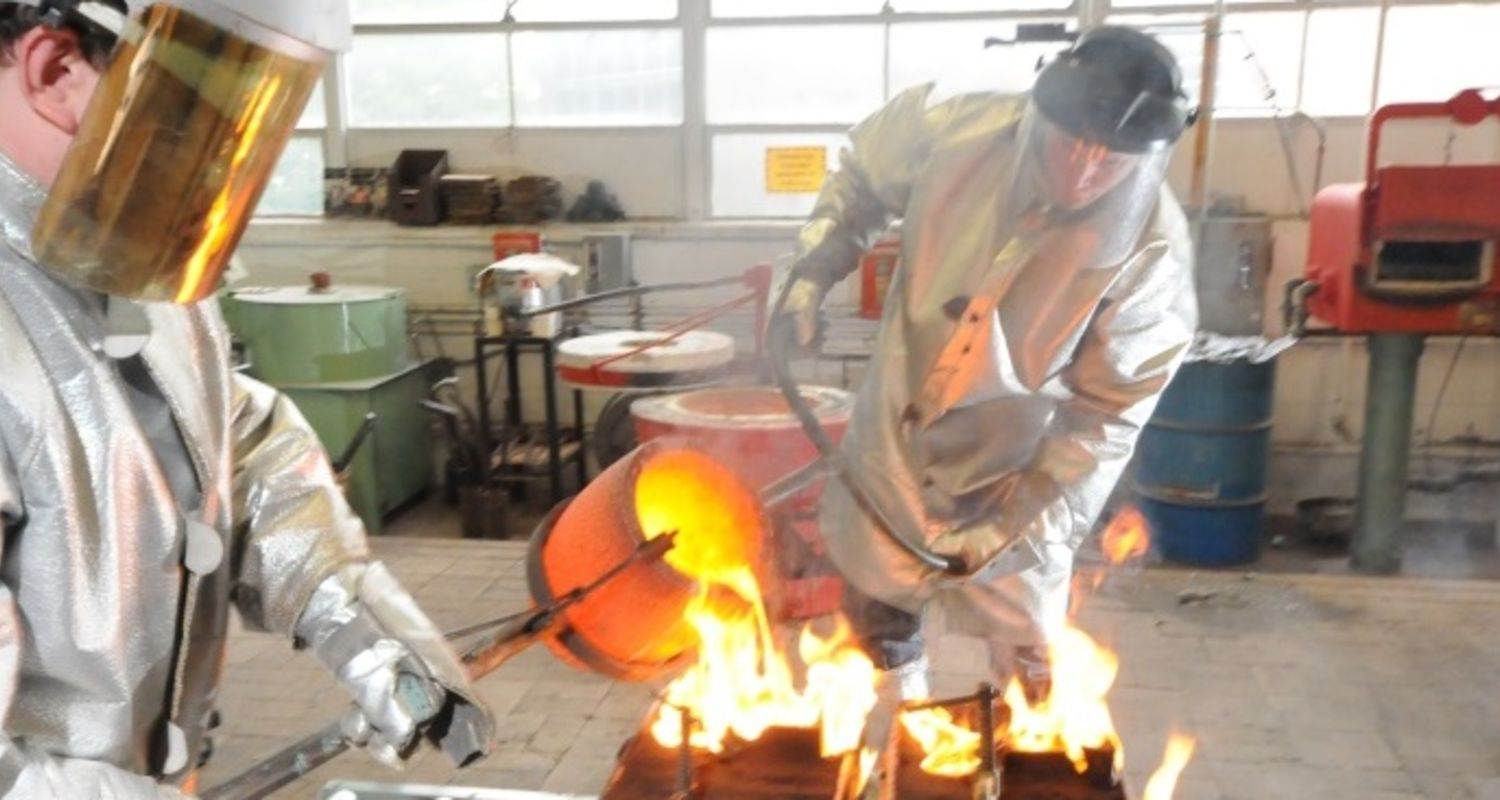 Students pourring molten metal