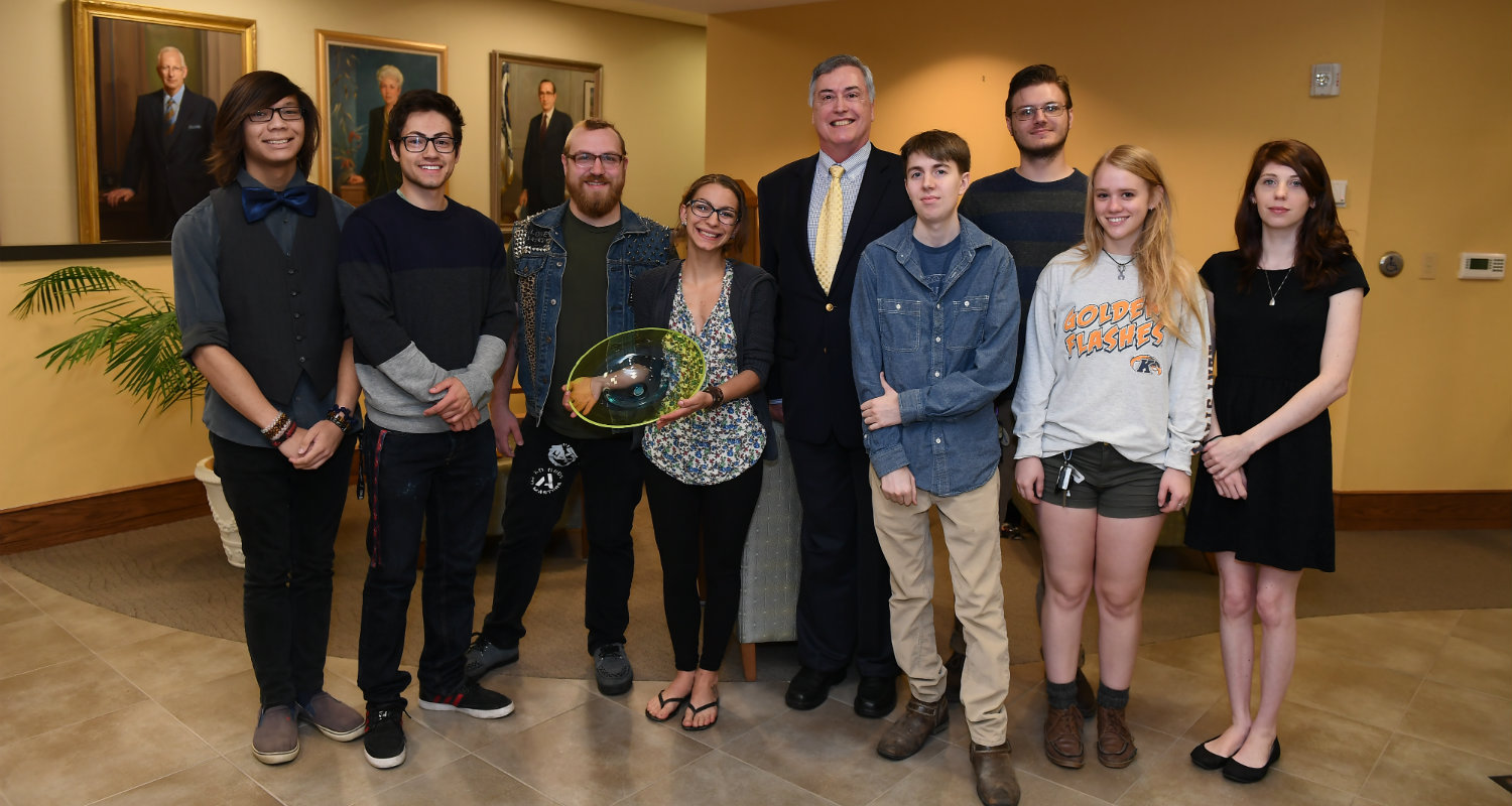 The School of Art's Glass Club created this specially-designed glass piece to present to Dr. Warren.  Pictured with Dean Crawford-Spinelli are some of the members, of Glass Club.