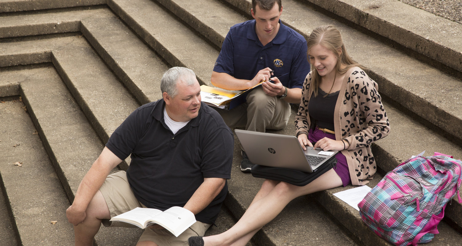 Students Sitting on Courtyard Steps