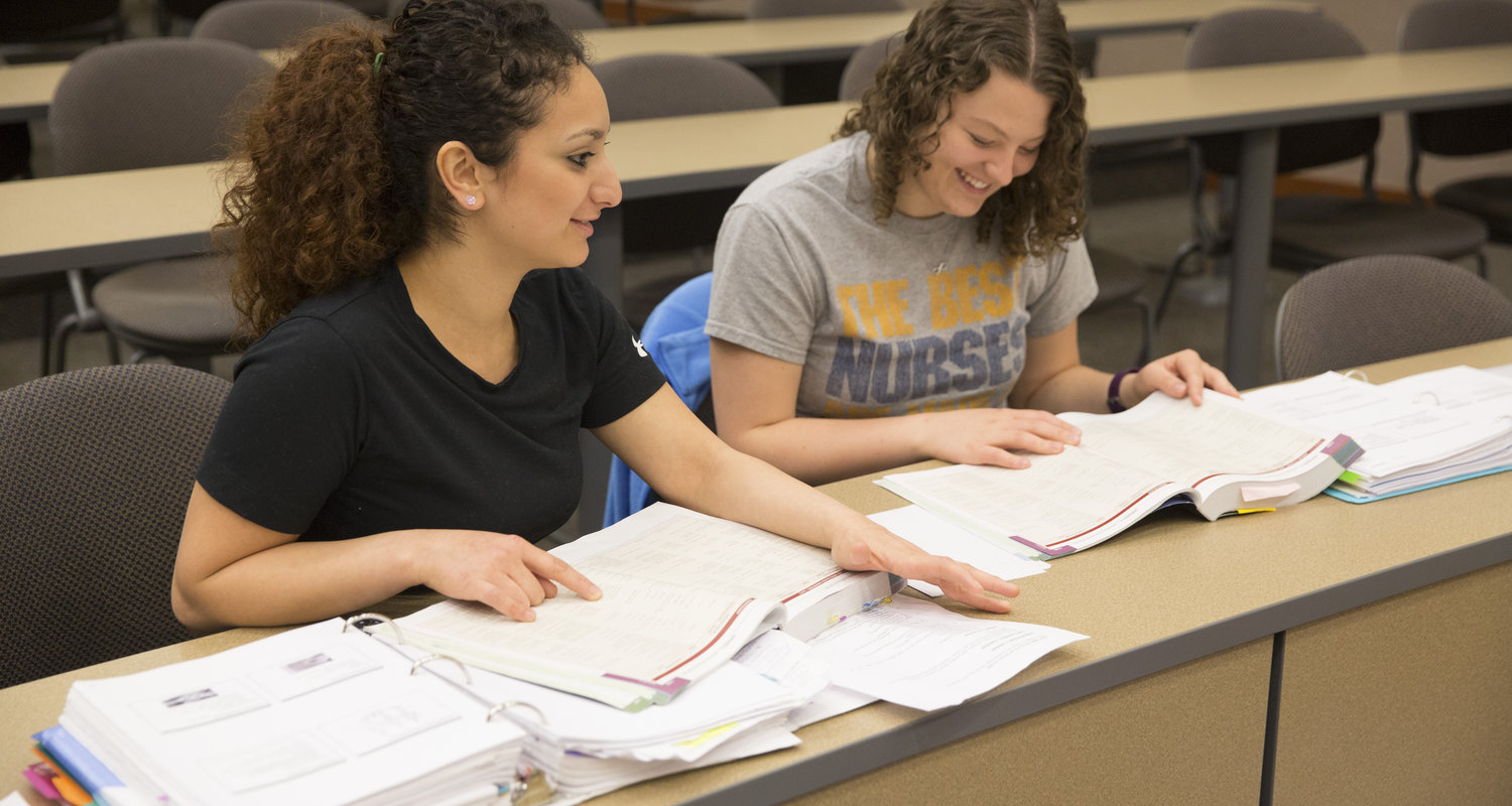 Two female Kent State Ashtabula students take part in a study session in Robert S. Morrison Hall