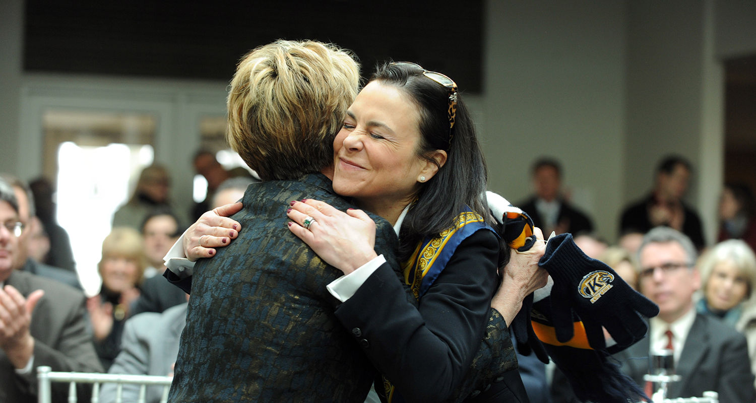 Jane Murphy Timken, chair of the Kent State Board of Trustees, gives Dr. Beverly J. Warren a hug during the announcement.