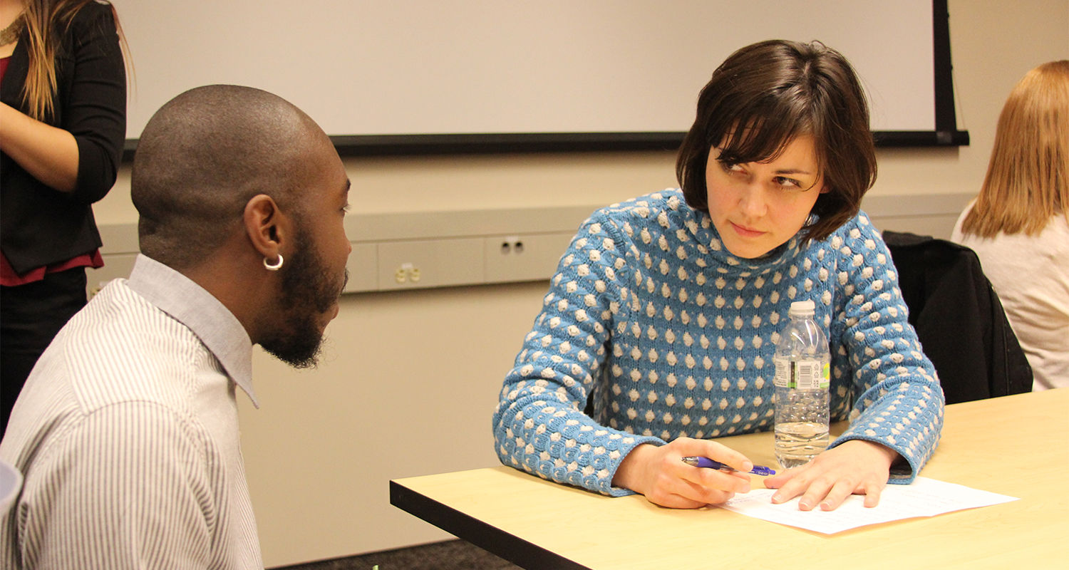 A Kent State public relations major speaks with an alumna during a Public Relations Student Society of America meeting. Graduates of the program returned to campus to speak with current students about career paths. (Photo credit: Brenna Parker)