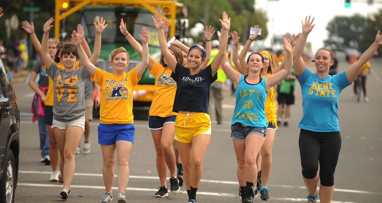 Dance majors from Kent State's College of the Arts dance down Main Street during the Homecoming Parade.