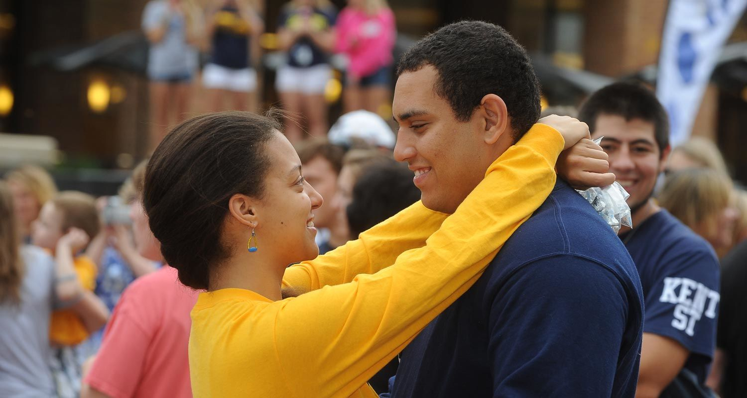 "A couple kisses during the ""Kiss on the K"" event at Homecoming."