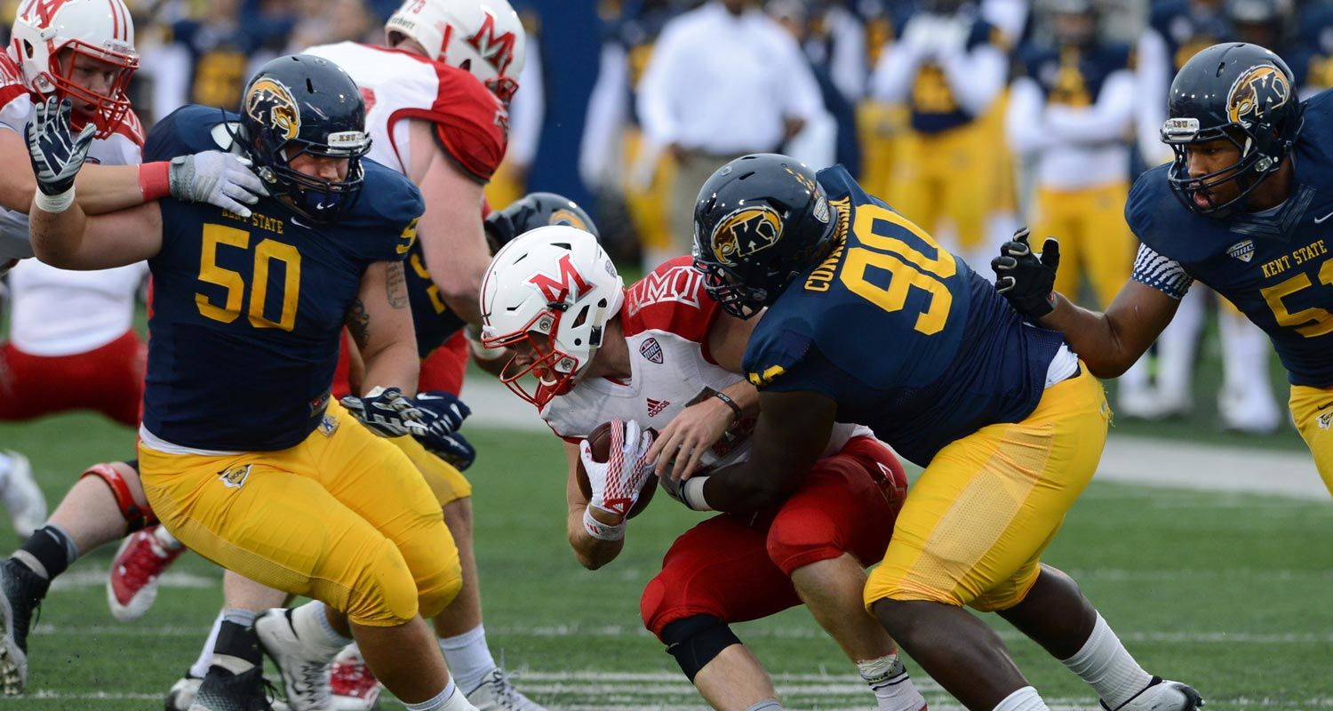 Kent State defensive tackle Jon Cunningham drops the Miami quarterback for a loss during the Golden Flashes 20-14 victory over the RedHawks at the 2015 Homecoming game at Dix Stadium.