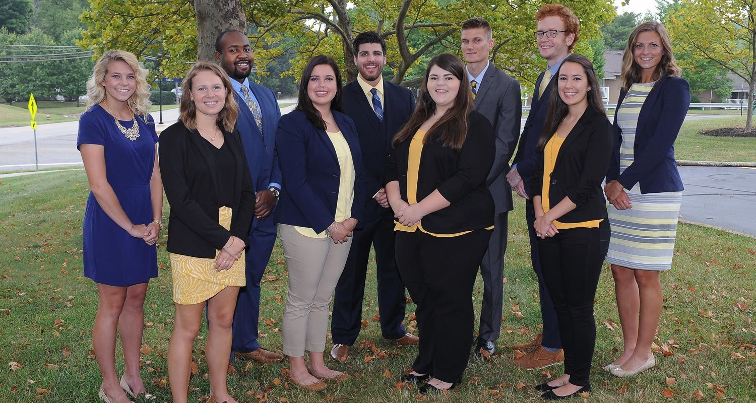 The members of Kent State's 2016 Homecoming Court wear blue and gold to show their Kent State pride.