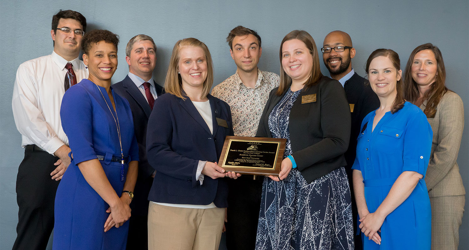 Kent State's Academic Success Center staff and Eboni Pringle (second from left), dean of the University College, pose for a group photo with the Frank L. Christ Outstanding Learning Center Award.