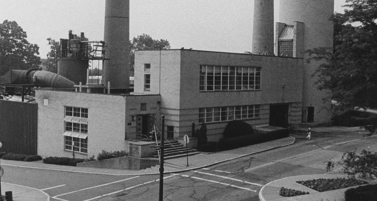 The Heating Plant (shown c. 1980s) constructed in 1916 (later additions) served as the primary heat source for the Kent Campus for nearly 80 years. During construction, the 120-foot brick stacks were found to be structurally unsound, and were demolished.
