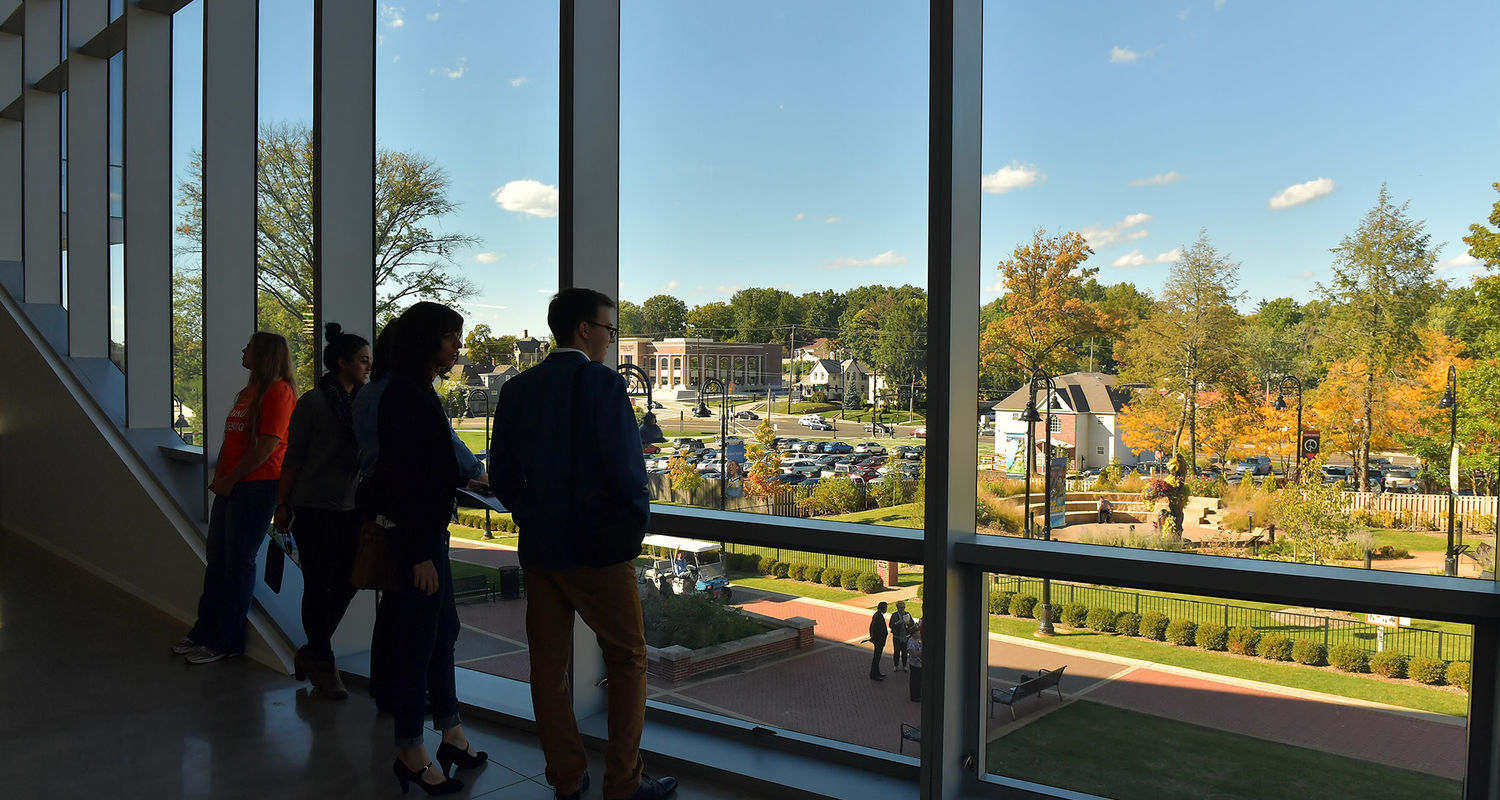 Visitors to Kent State's new Center for Architecture and Environmental Design enjoy the view of the Wick Poetry Center and downtown Kent.