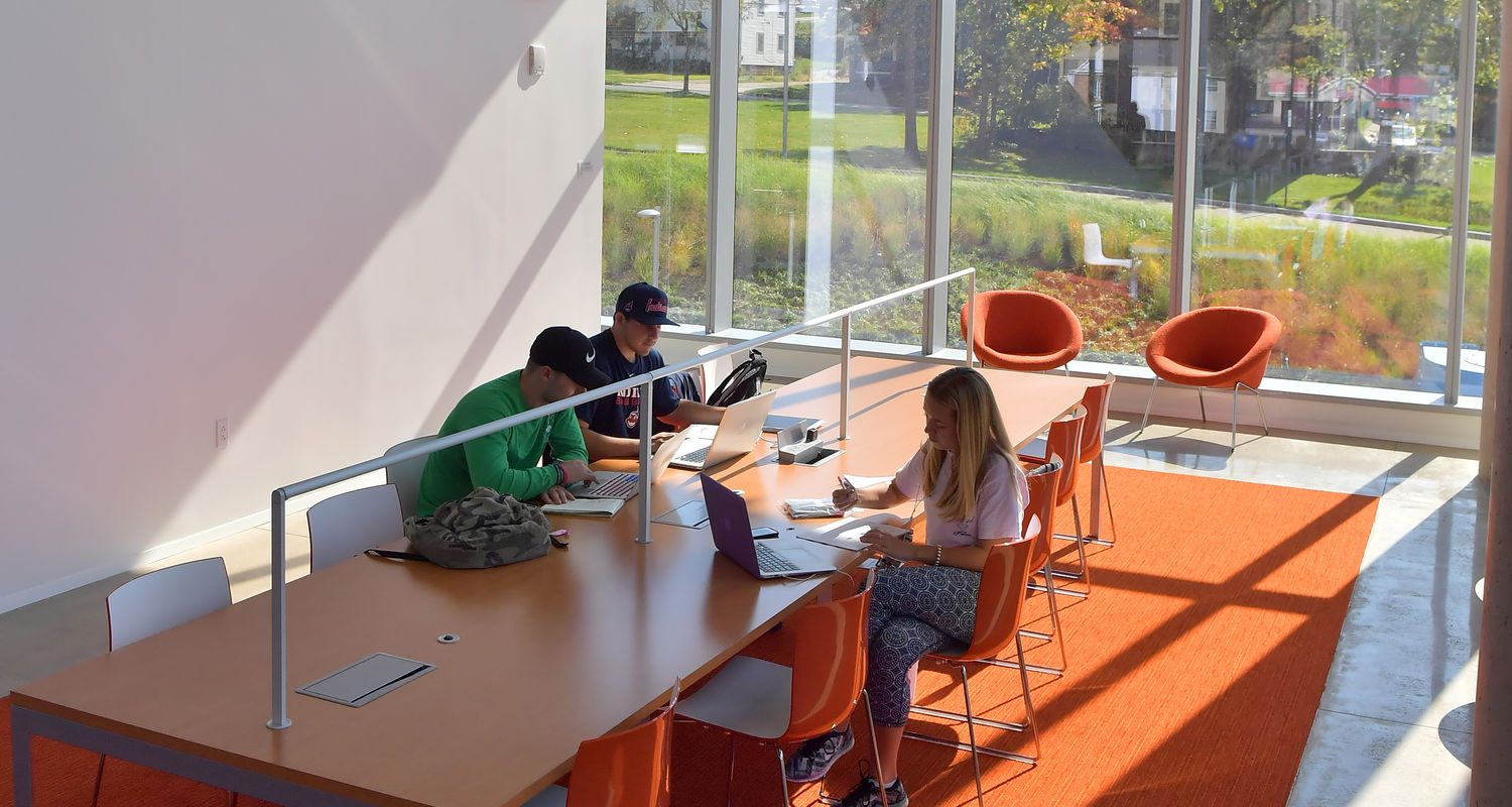 Students study in a light-filled space on the first floor. Glass walls optimize daylight and overlook the immediate neighborhood.
