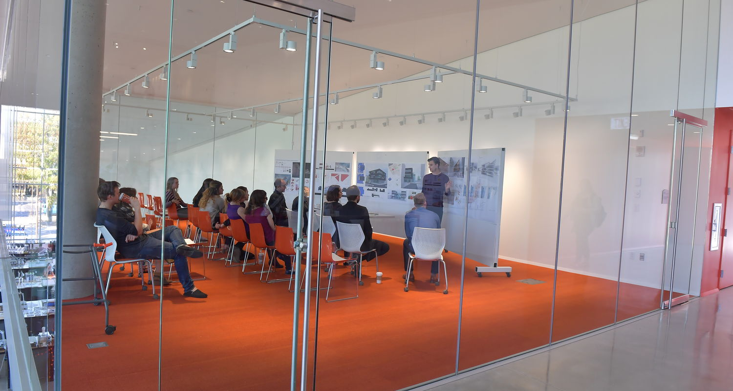 Glass-enclosed critique spaces give everyone an opportunity to observe student presentations.