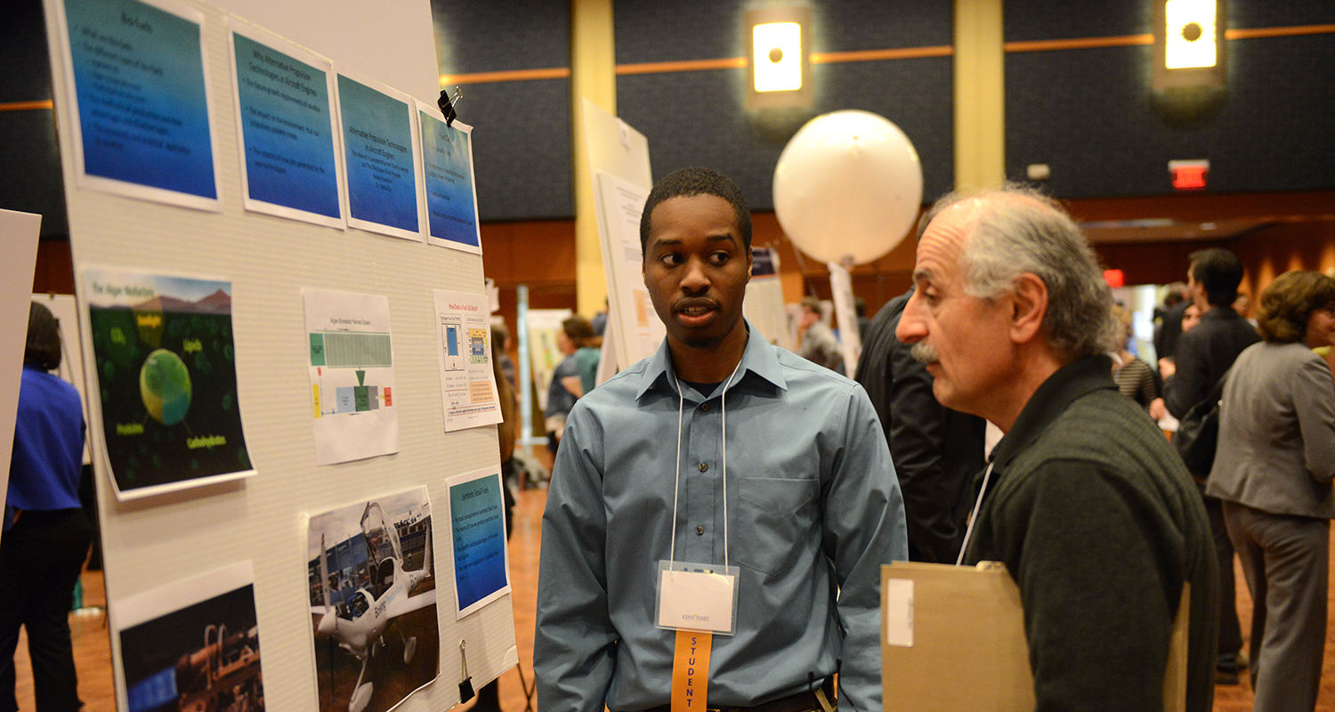 A Kent State technology student shows his research off to a professor during the Undergraduate Research Symposium.