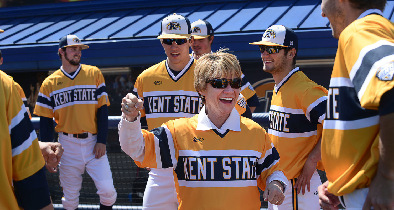 Kent State President Beverly Warren sports her new baseball jersey while firing up the baseball team before a doubleheader with the Oakland Golden Grizzlies at Schoonover Stadium.