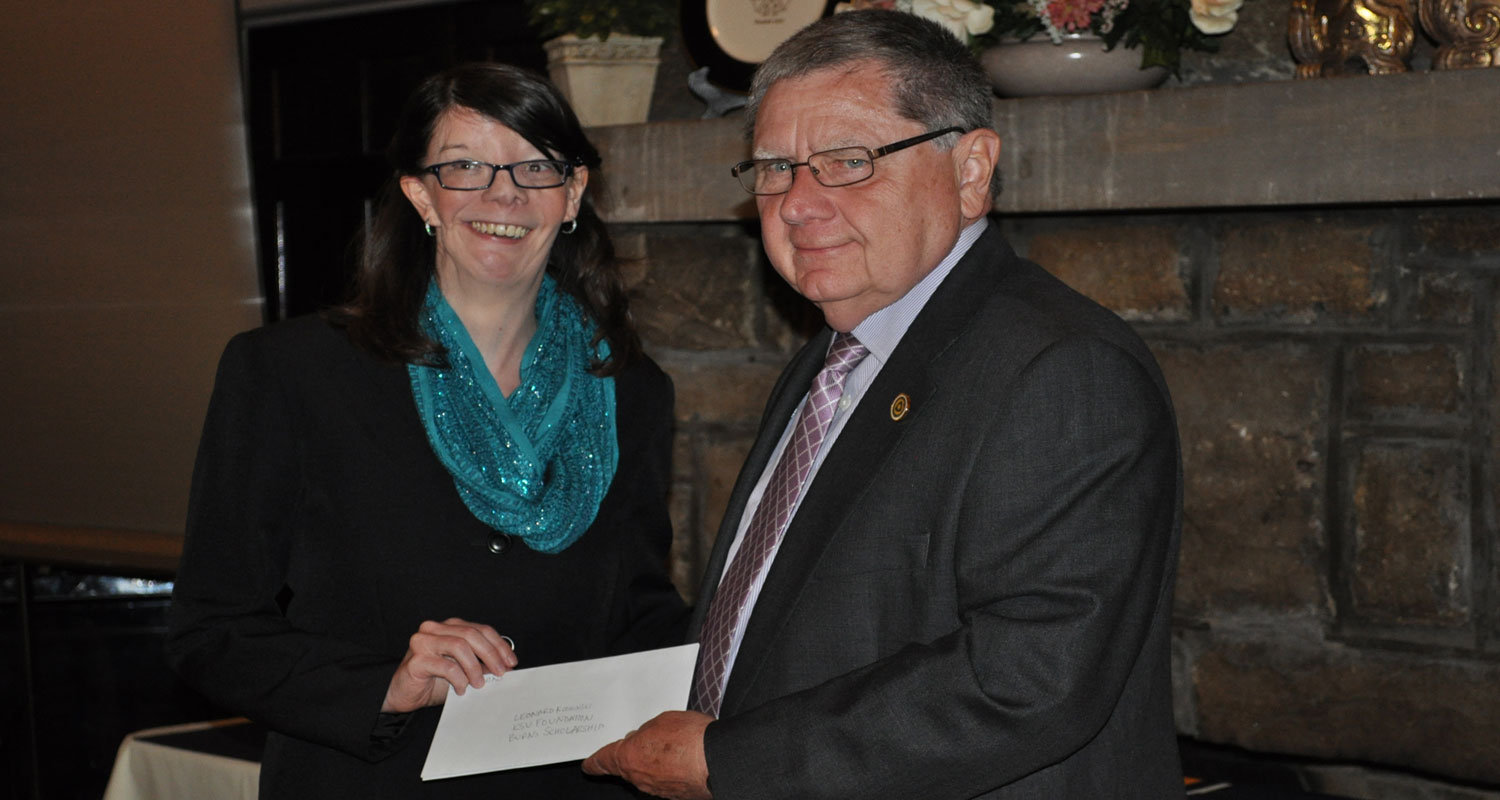 A check establishing the Dr. Roxanne Burns Endowed Scholarship was presented by Emily Burns, daughter of the late biology professor, to Leonard Koshinski, director of advancement for the Kent State Columbiana County campuses.