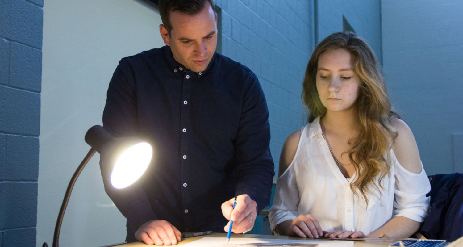 VCD professor Christopher Darling helps sophomore Emily Gommel on her still life assignment during a Design Illustration Techniques class