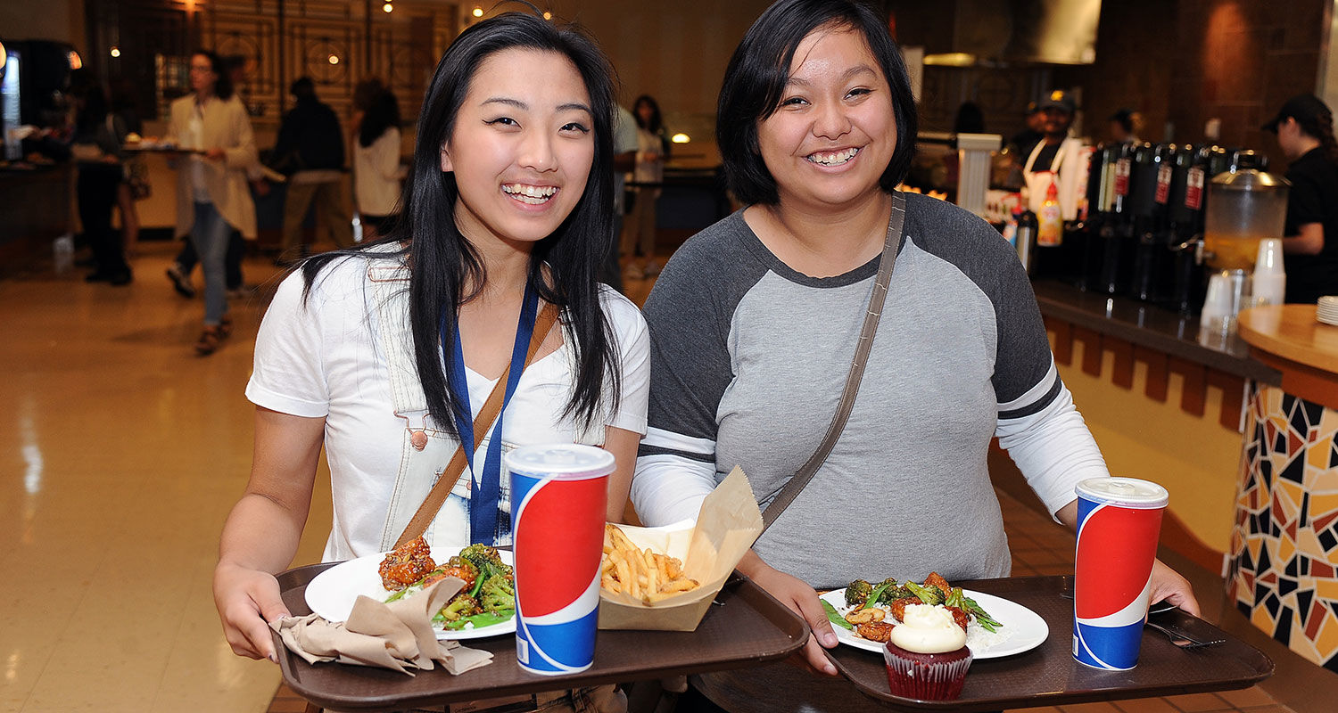 Two Kent State friends grab a bite to eat at Eastway Center.