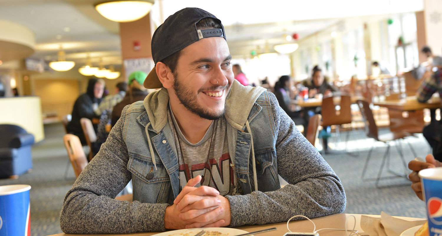 A Kent State student talks with friends after a meal at Eastway Center.