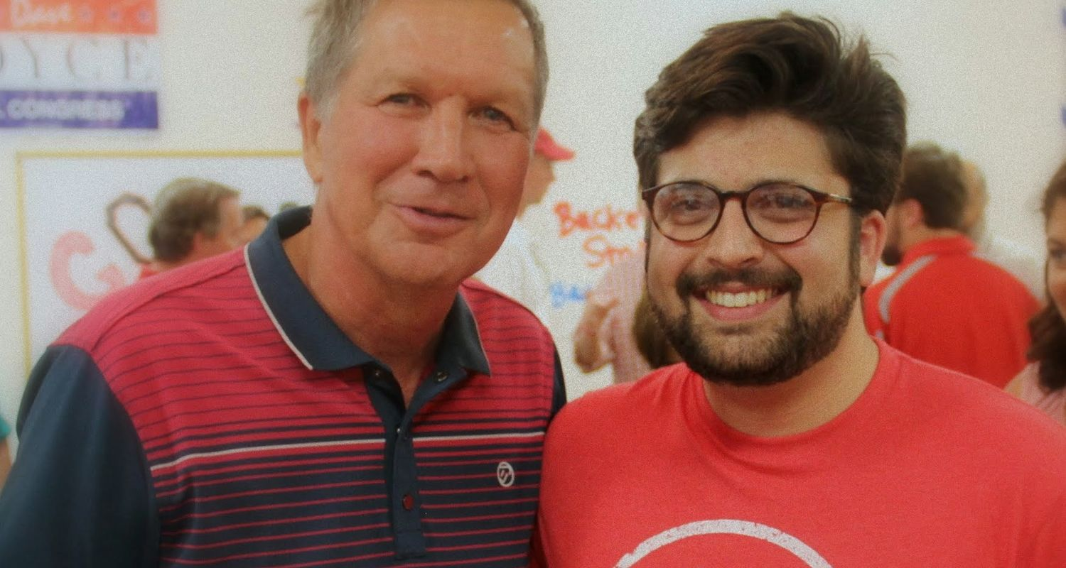 Image of Michael Guastella, '15 PoliSci graduate standing next to Governor Kasich