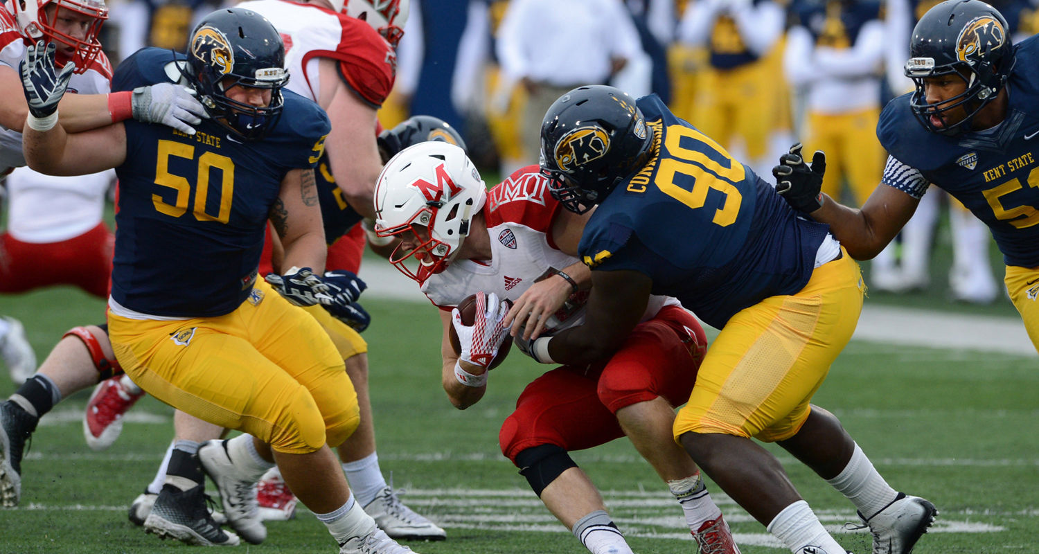 Kent State defensive tackle Jon Cunningham drops the Miami quarterback for a loss during the Golden Flashes 20-14 victory over the RedHawks at Dix Stadium.
