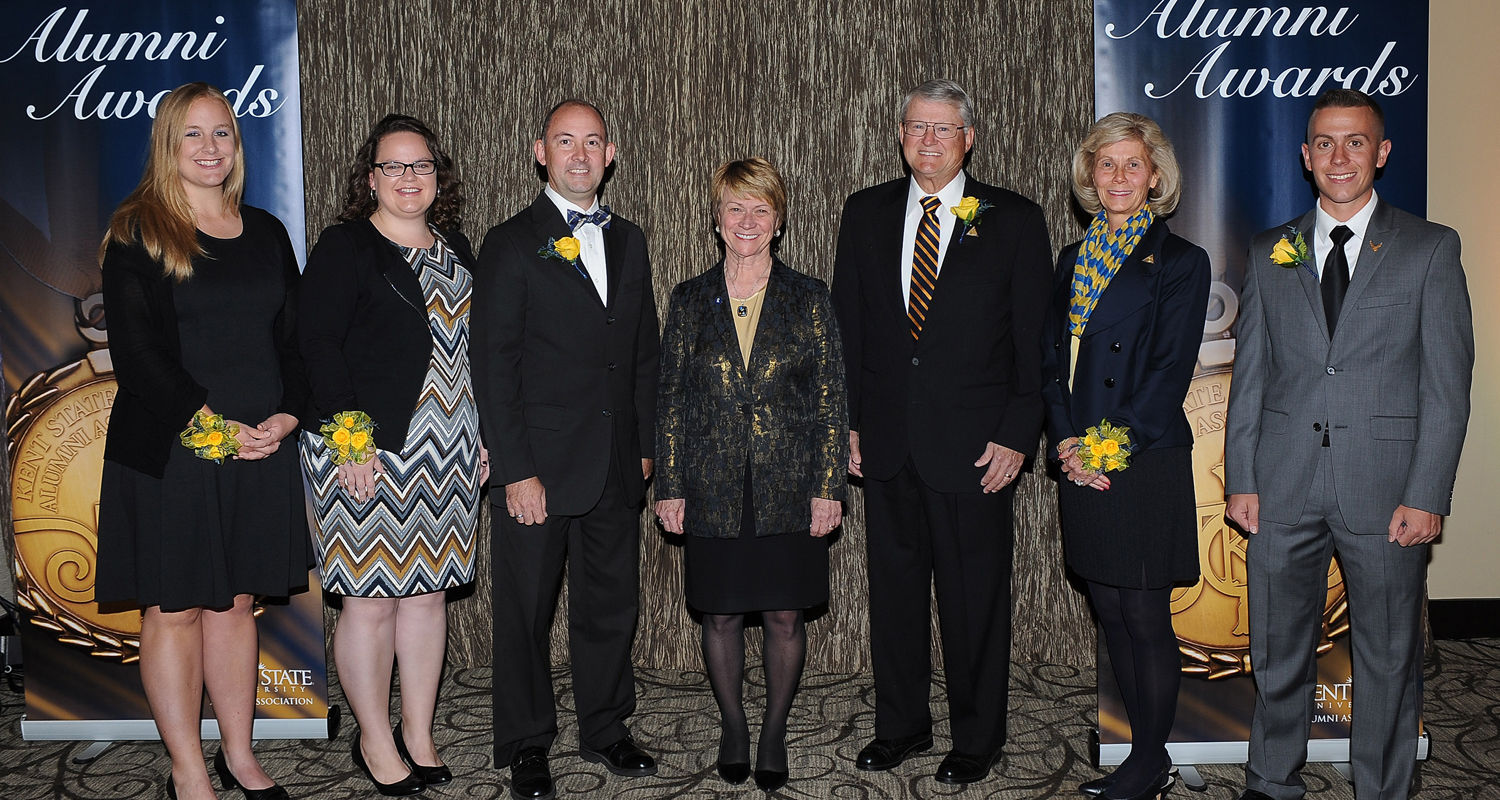 The winners of the 2015 Distinguished Alumni Awards celebrate with Kent State President Beverly Warren at the Kent State Hotel and Conference Center the evening before Homecoming.