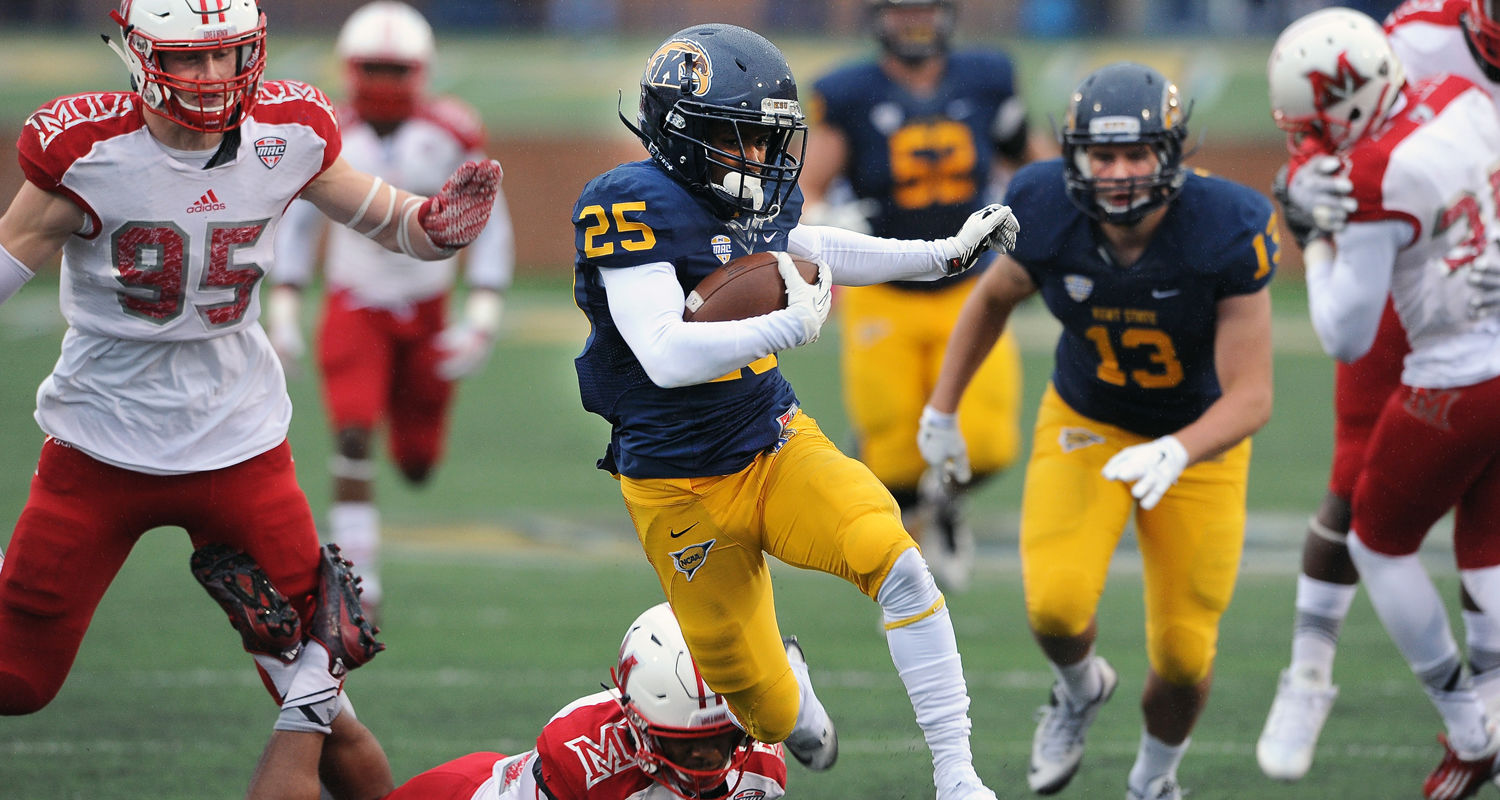 Kent State wide receiver Ernest Calhoun eludes Miami defenders en route to a big third quarter gain during Kent State's 20-14 win at Dix Stadium.