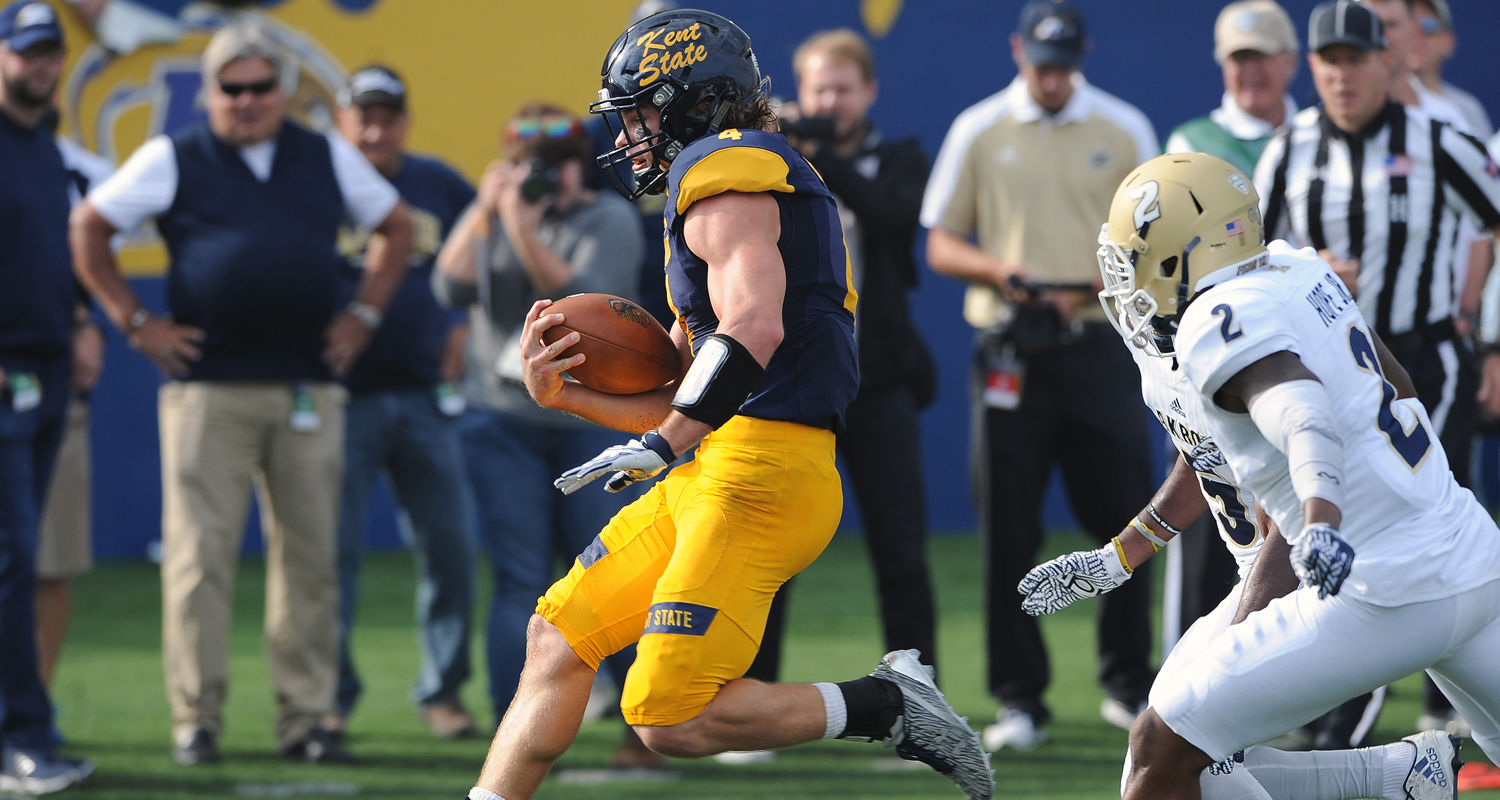 Kent State quarterback Nick Holley leaps into the end zone for a first half touchdown during the Homecoming game at Dix Stadium.