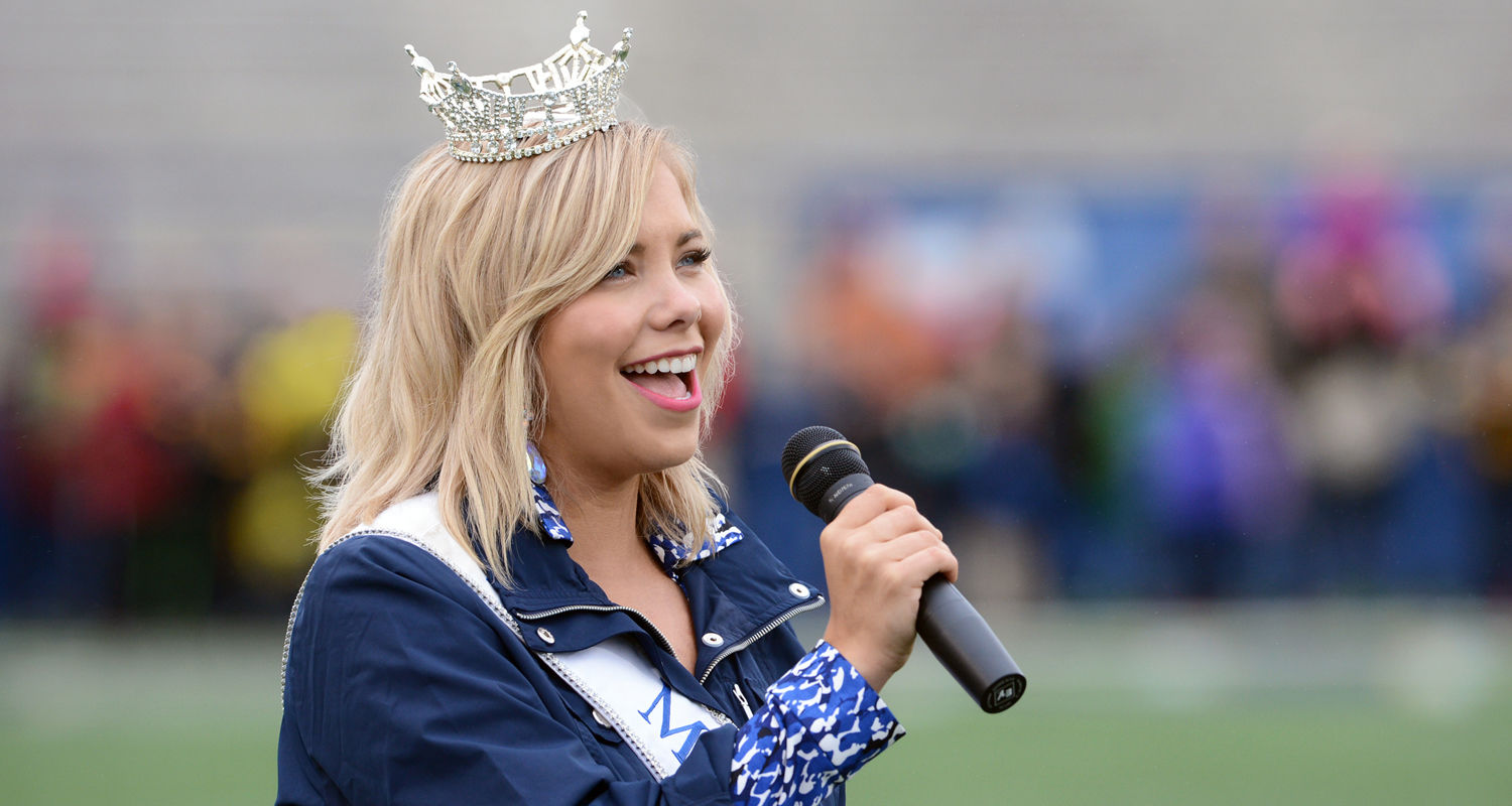 Kent State graduate student Sarah Hider, crowned Miss Ohio 2015, sings the National Anthem prior to the start of the kickoff of Kent State's 20-14 win over Miami at Dix Stadium during the 2015 Homecoming celebration.