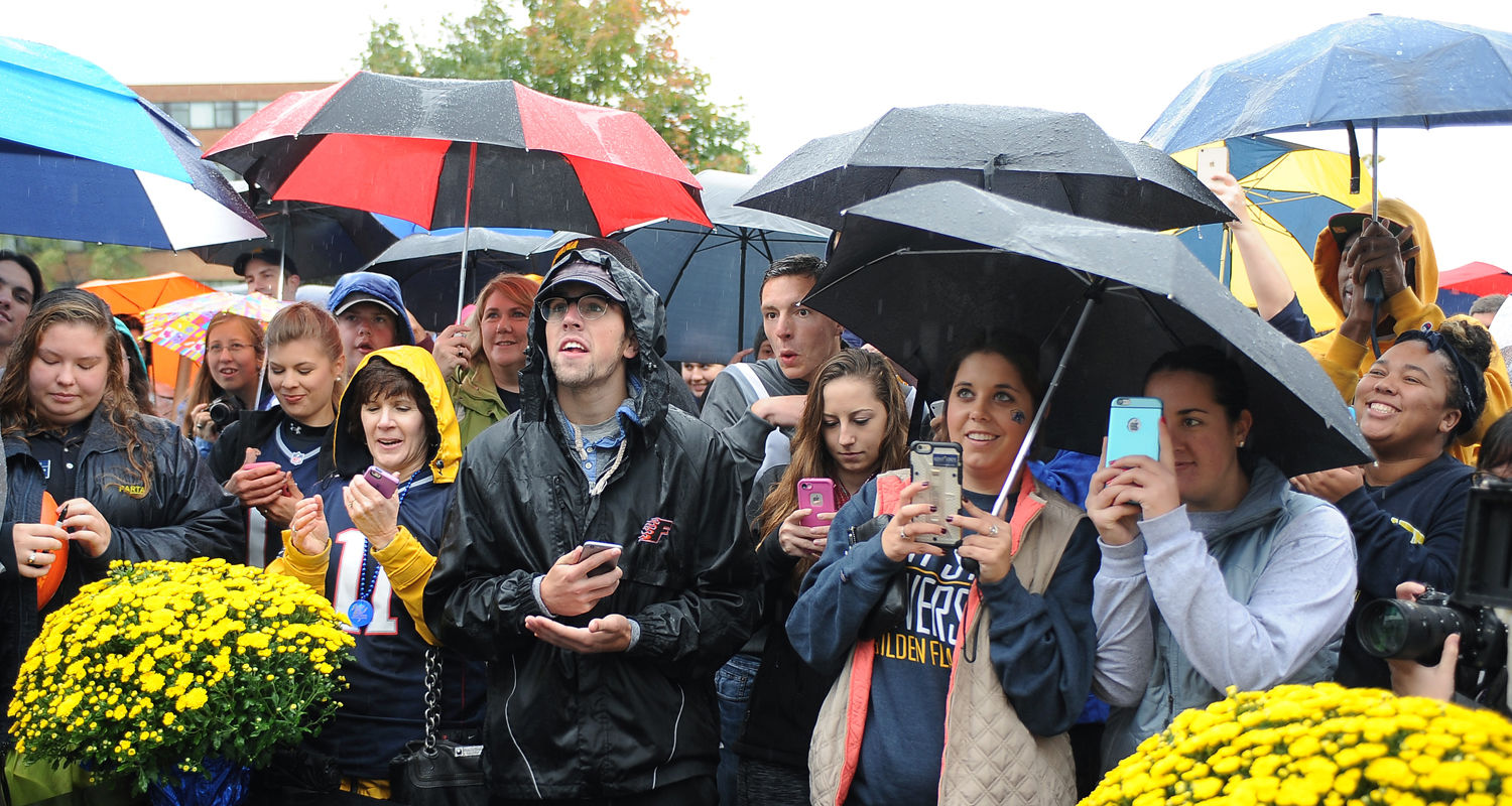 Kent State students and Kent community residents gather to meet and greet Kent State alumnus and Super Bowl champion Julian Edelman as he welcomed them to the Williamson Alumni Center just before the 2015 Homecoming parade.