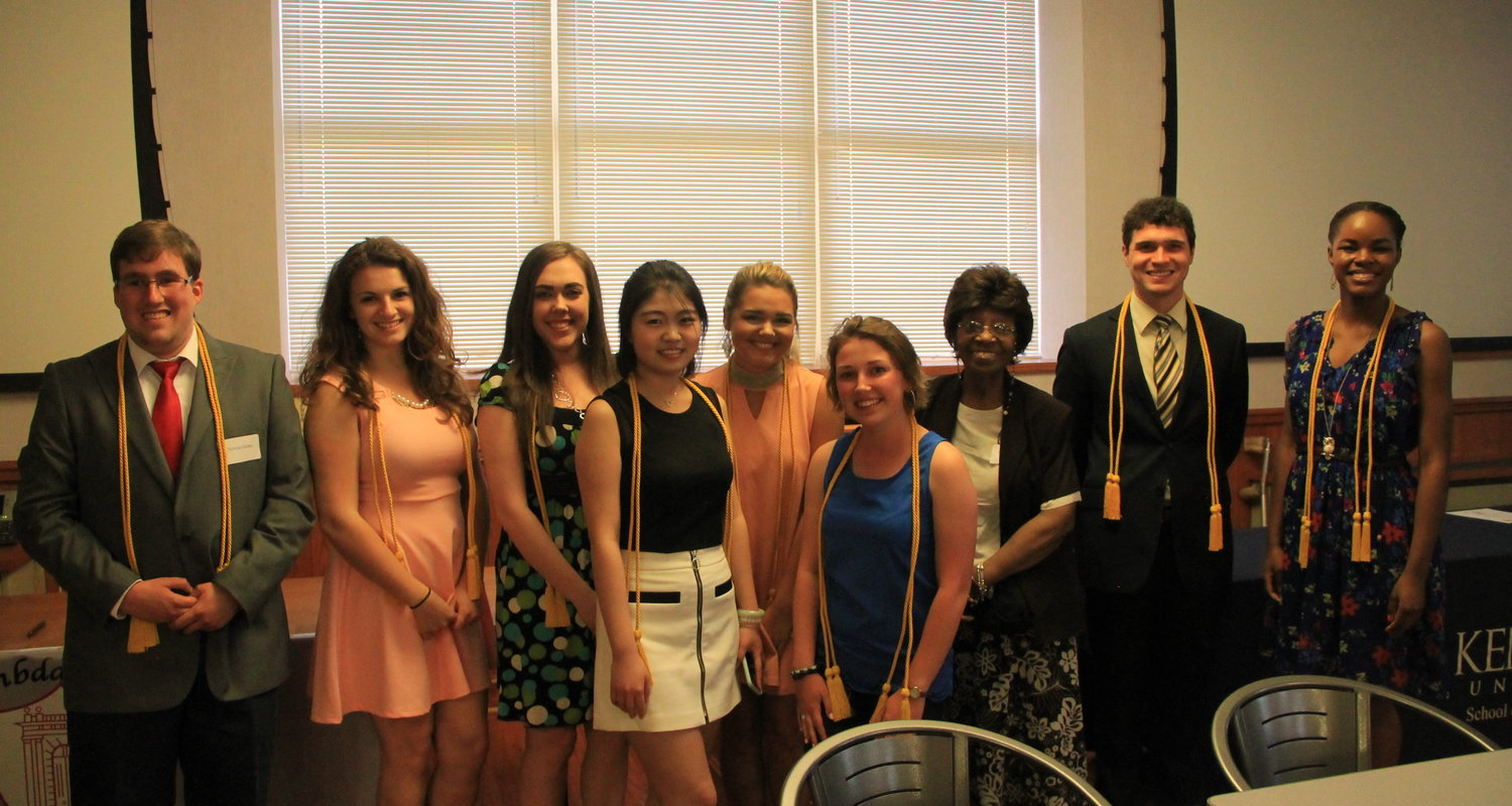 Rozell Duncan poses with members of Lambda Pi Eta and KCS