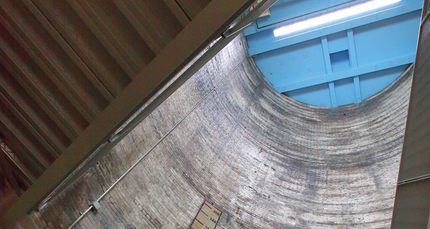 The existing coal silo now houses a staircase linking four floors of studios and support areas.
