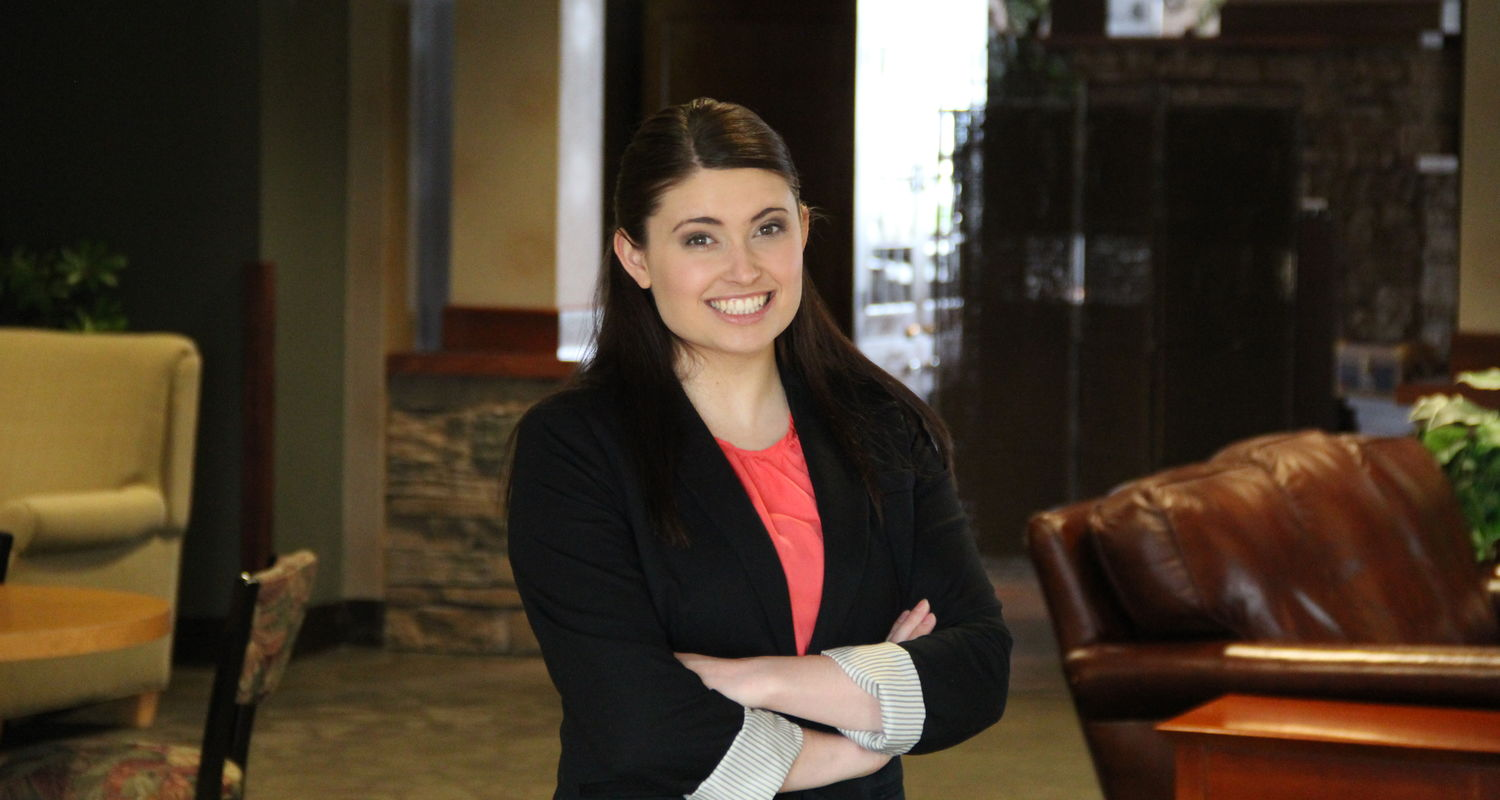 a female Kent State Ashtabula hospitality management student working at a local resort
