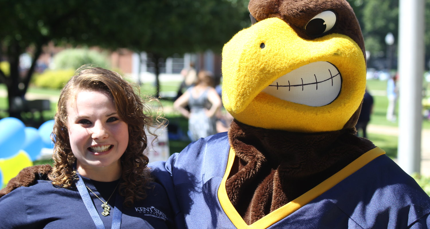 A Kent State Ashtabula Student Ambassador and Flash hang out on campus during Welcome Back Days