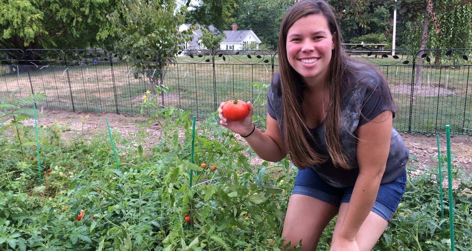 Sarah Burns shows off tomato from garden