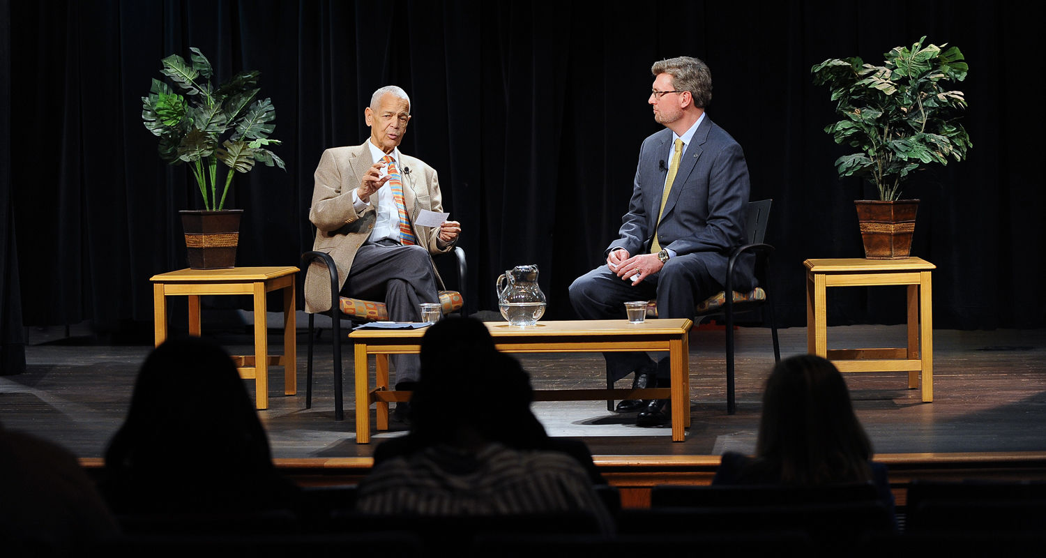 Thor Wasbotten, right, director of Kent State's School of Journalism and Mass Communication, serves as a moderator for a dialogue with civil rights leader Julian Bond in Ritchie Hall's African Community Theatre.