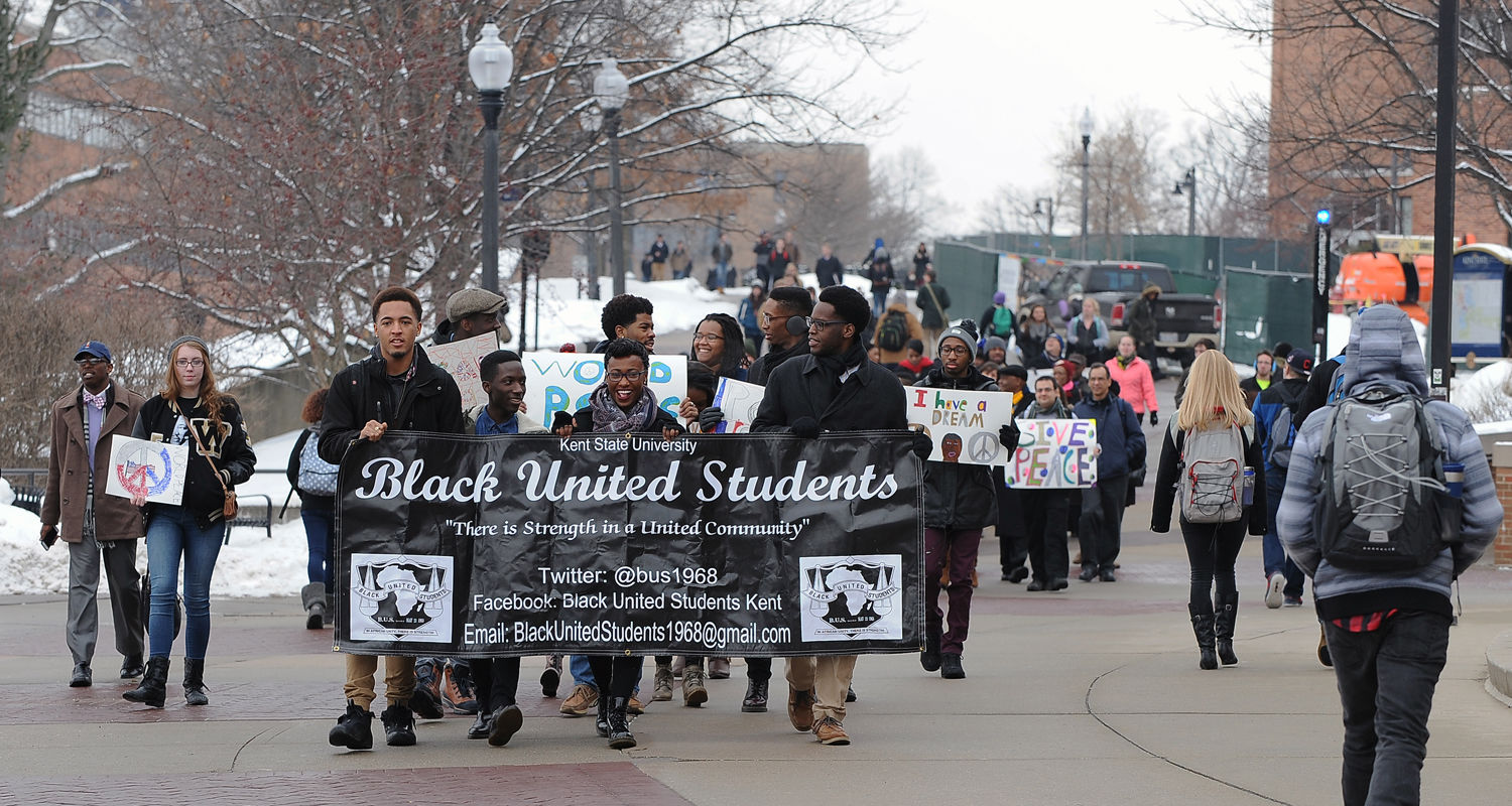 Kent State students march toward the Kent Student Center along the Lefton Esplanade to a ceremony in honor of the legacy of Martin Luther King Jr.