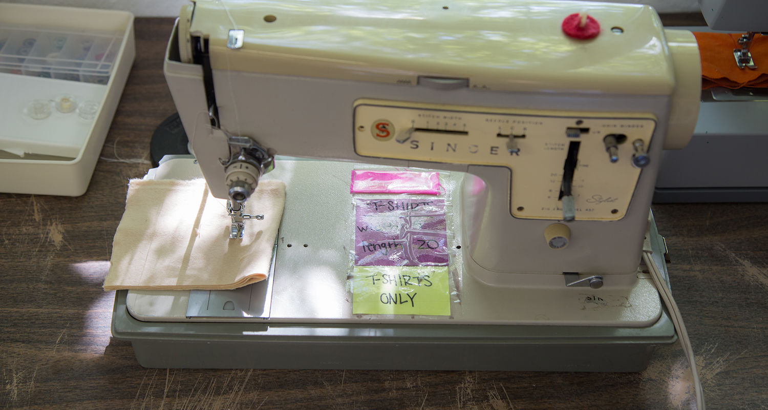 Ka Naw still uses the sewing machine she brought to Neighbors Apparel as its first employee.