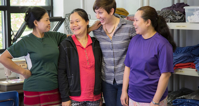 Enjoying a break together at Neighbors Apparel. From left: Ka Naw, Kaser Paw, Tessa Reeves and Wah Wah Say