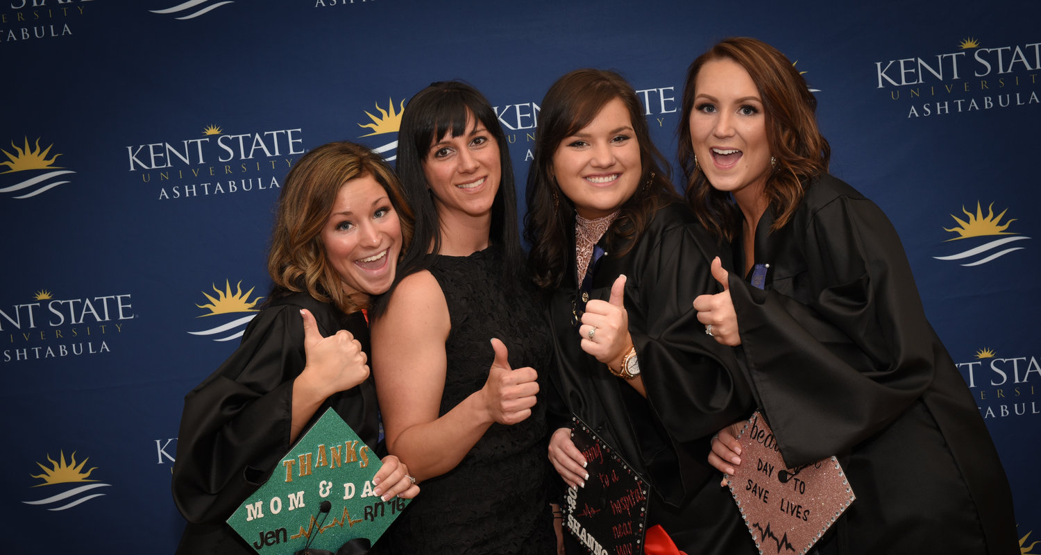 Four female Kent State Ashtabula students celebrate graduation