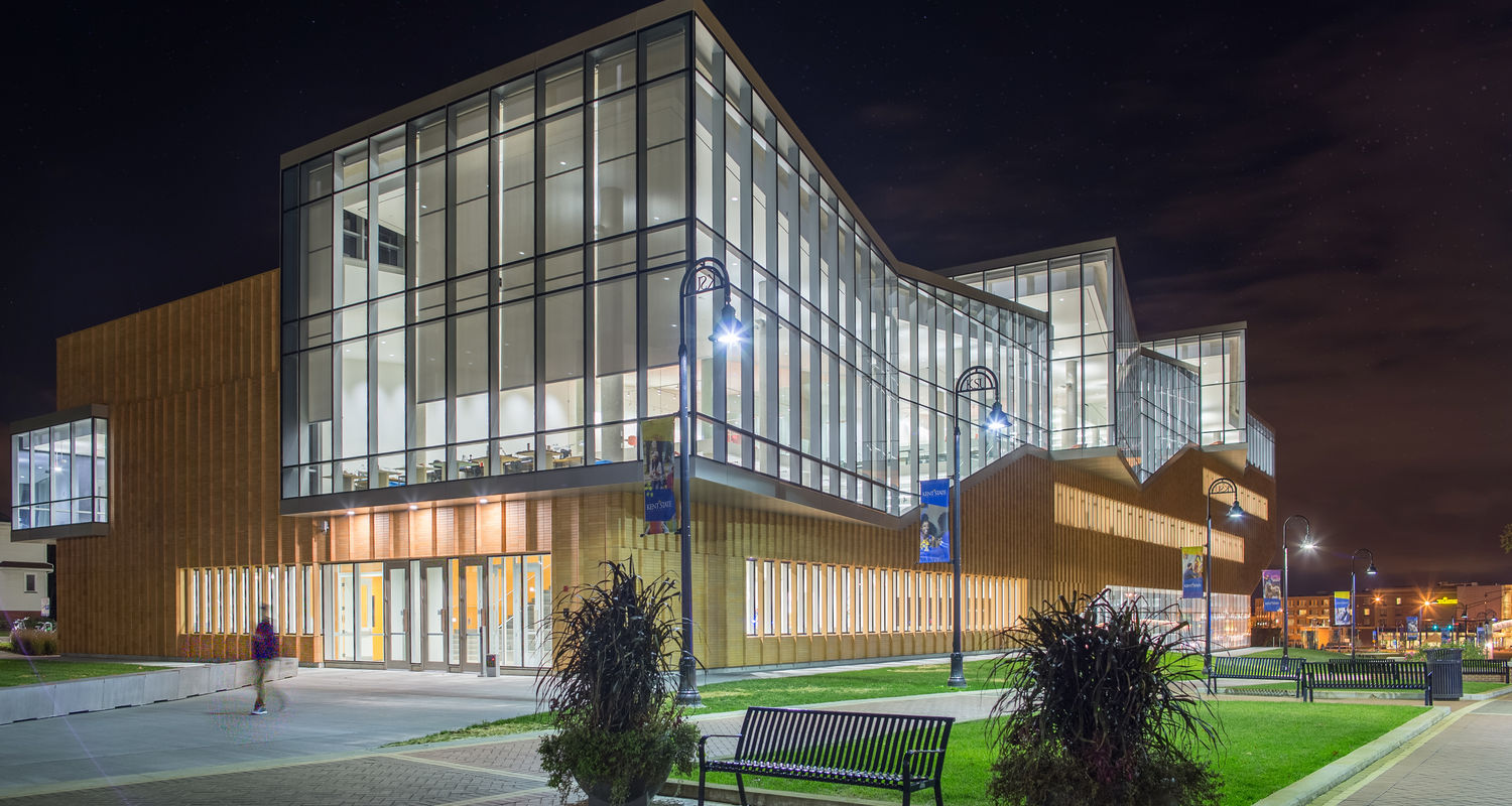 The building's north facade faces the Lefton Esplanade, which links the campus with the city of Kent.   For visitors approaching from downtown Kent, the building sits at the entrance to the campus and gives a strong first impression of the university.