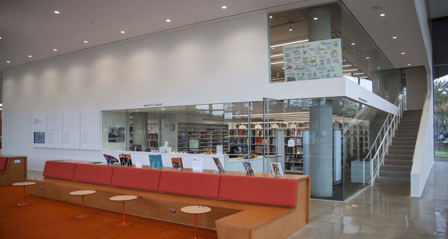 The lower level of the long entrance gallery supports a range of uses, including the reading room and library shown at left. Stairs lead to the second floor faculty suite.