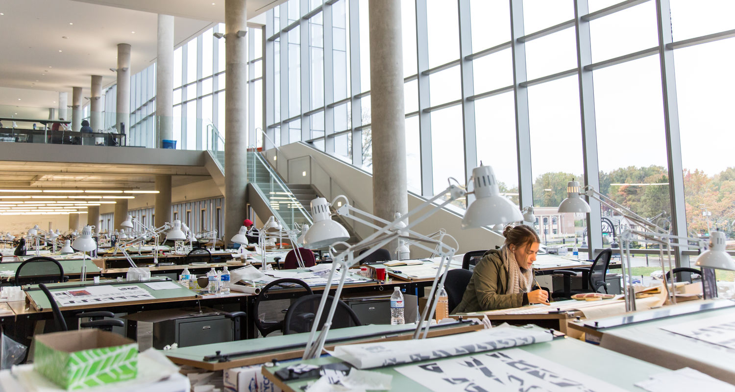 A cascading stair along the north facade connects three levels of studio space, allows a light-filled view of student work and encourages interaction among students from different disciplines.