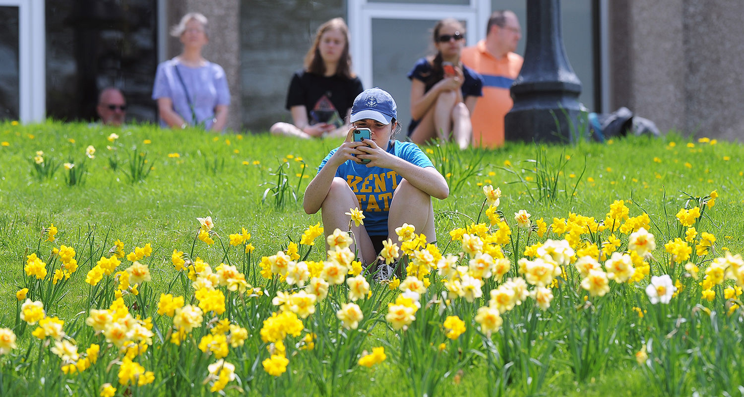 A Kent State student takes photos of the 45th annual commemoration of May 4, 1970, on the hill beside Taylor Hall.