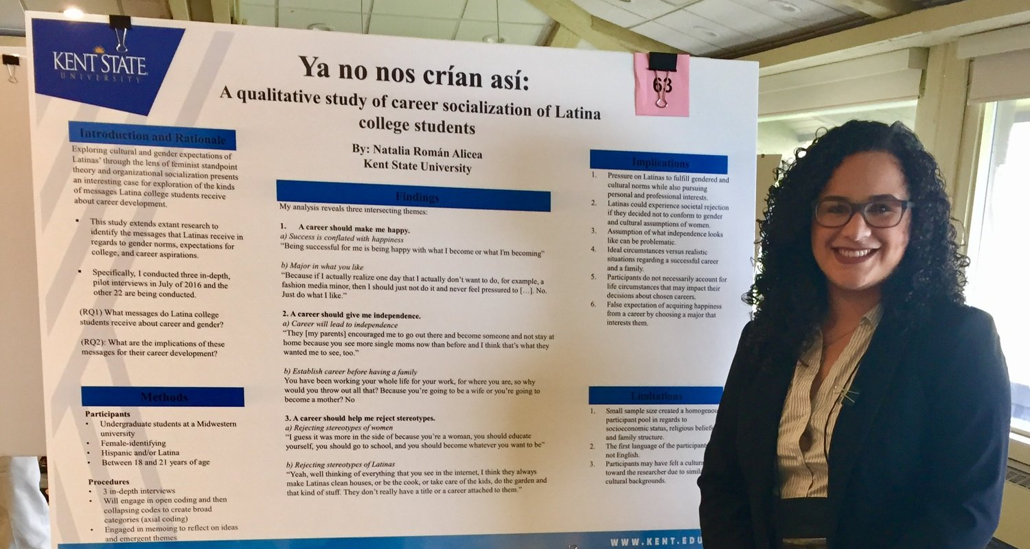 Natalia Roman, senior communication studies major, presents a poster session on her thesis research.