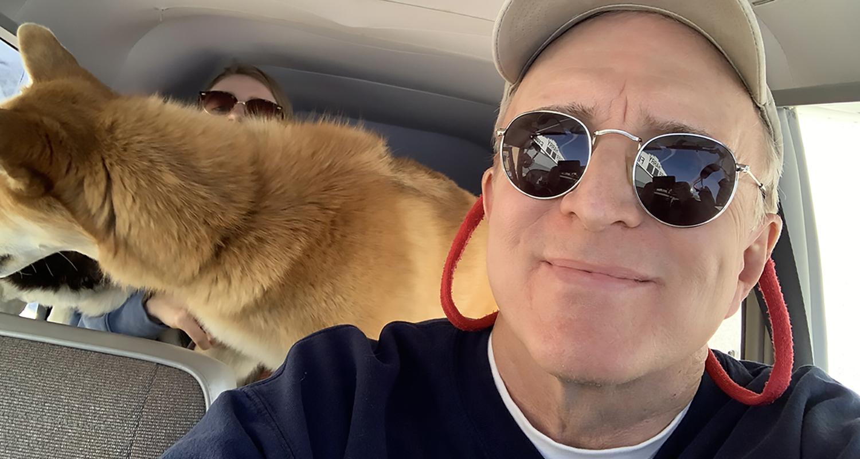 Professor Joe Murray flies a plane with a dog behind him