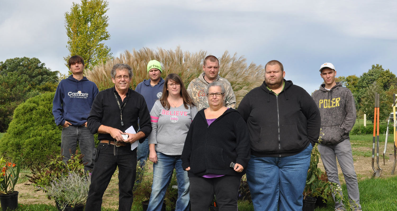 Working on the butterfly garden on the Kent State University at Salem campus are (front, from left) Associate Professor Chris Carlson, Samantha Keshock, Joy Draper, Steven Harvey; and (back, from left) Phillip Grover, Matt Baird, Jeremy Roark and Andy Rus