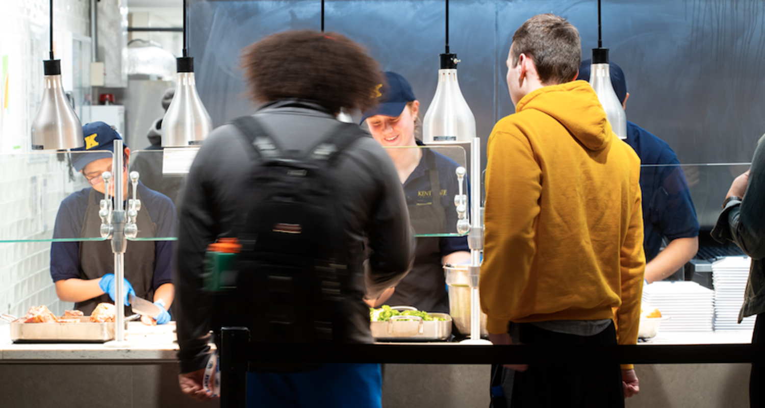 Kent State students wait for food at Eastway Fresh Food Co.